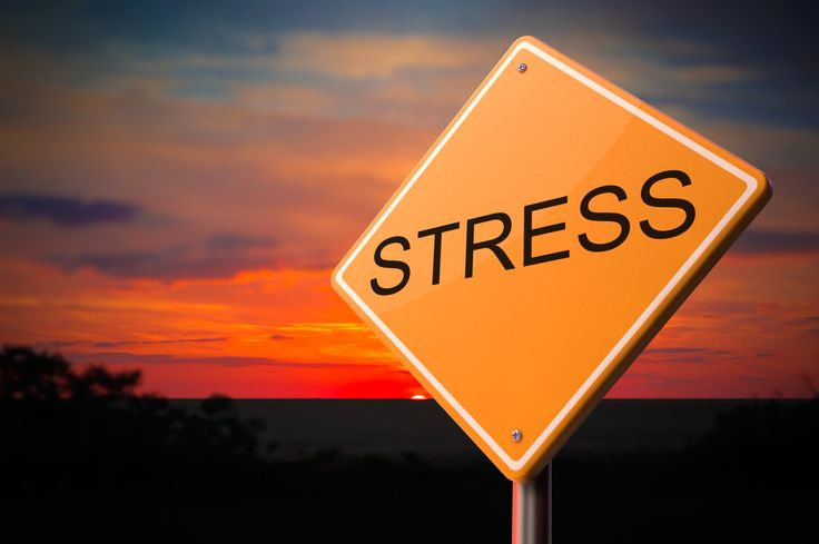 Stress on Warning Road Sign on Sunset Sky Background.